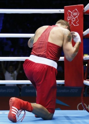 Oleksandr Usyk of the Ukraine kneels in